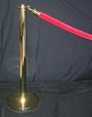 brass stanchion and red velvet roping